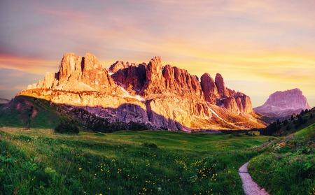 Foto de Dolomites landscape with mountain road. Rocky Mountains at sunset. Alps, Italy - Imagen libre de derechos