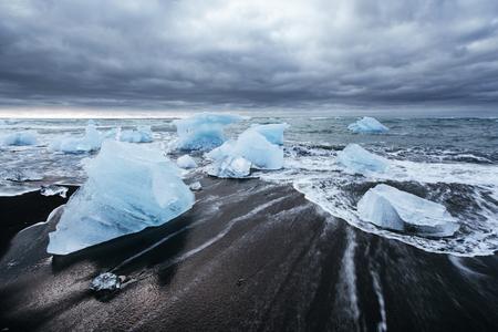 Photo for Jokulsarlon glacier lagoon, fantastic sunset on the black beach, Iceland. - Royalty Free Image