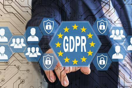 Foto de The businessman chooses the GDPR on the touch screen .General Data Protection Regulation concept . - Imagen libre de derechos