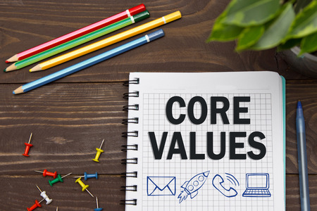 Foto de Notebook with a Business notes CORE VALUES on the office table with tools. Concept CORE VALUES with elements of infographics. - Imagen libre de derechos
