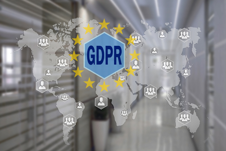 Foto de GDPR  on the touch screen with a blur background of the office.The concept of General Data Protection Regulation - Imagen libre de derechos