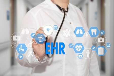 Foto de Electronic health record. EHR on the touch screen with medicine icons on the background blur Doctor in hospital. - Imagen libre de derechos