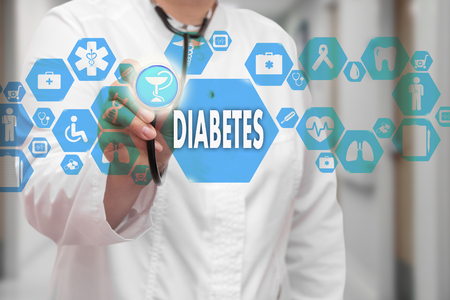 Foto de Medical Doctor with stethoscope and Diabetes icon in Medical network connection on the virtual screen on hospital background.Technology and medicine concept. - Imagen libre de derechos