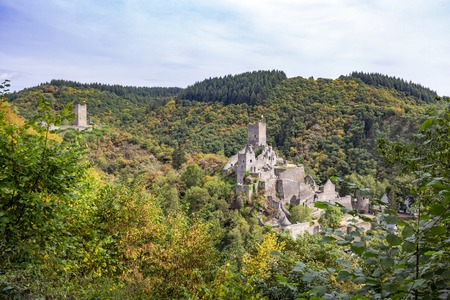 Photo for Autumn panoramic view to the ruins of Oberburg and Niederburg, the Upper and Lower Castle of Manderscheid, Germany as seen from the main street - Royalty Free Image