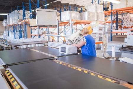 Photo pour Industrial Mattress production. Factory worker completes the production of the mattress sample - image libre de droit