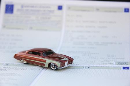 Foto de Vehicle registration certificate and vintage car - Imagen libre de derechos