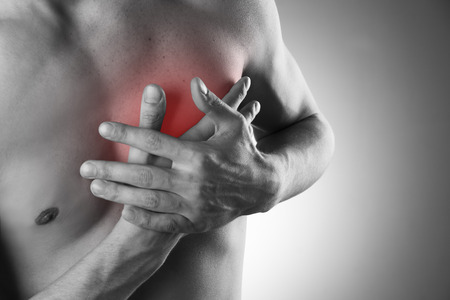 Foto de Heart attack. Pain in the human body.  Black and white photo with red dot - Imagen libre de derechos