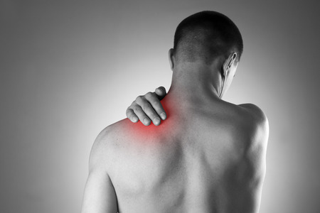 Photo pour Man with pain in shoulder. Pain in the human body. Black and white photo with red dot - image libre de droit