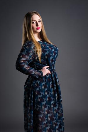 Foto für Plus size fashion model in long dress, fat woman on gray studio background, overweight female body, blonde hair and make-up - Lizenzfreies Bild