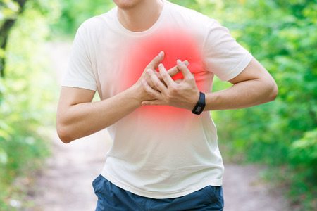 Photo pour Man with heart attack, injury while running, trauma during workout, outdoors concept - image libre de droit