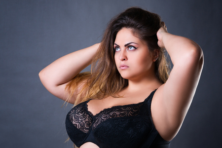 Foto für Plus size sexy model in black bra, fat woman with big natural breast on gray studio background, overweight female body, long hair and make-up - Lizenzfreies Bild