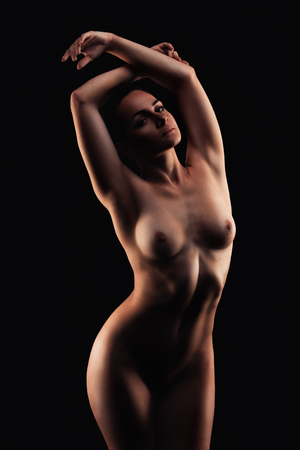 Foto de sexy woman sitting on black background, studio shot - Imagen libre de derechos