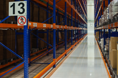 Foto de Warehouse and a modern system of targeted storage of products and goods. View from the bottom up on multi-level racks and boxes on shelves. - Imagen libre de derechos