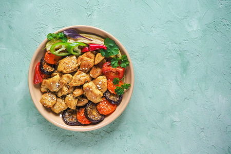 Photo pour Pieces of baked meat with grilled vegetables on a plate - image libre de droit