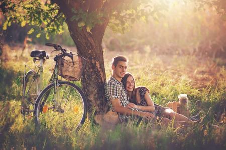 Photo pour Attractive couple at countryside - image libre de droit