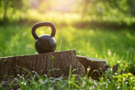 Photo for Outdoor photos from the kettlebell in the park, sunset in the background - Royalty Free Image
