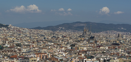Foto de City of Barcelona, among buildings Sagrada Familia - Imagen libre de derechos