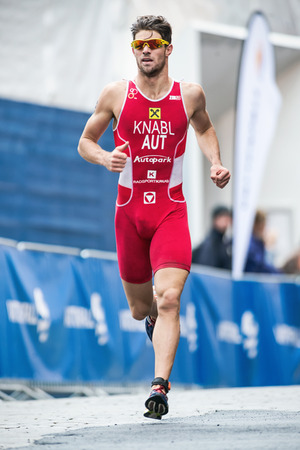 Photo pour STOCKHOLM - AUG, 23: Alois Knabl from Austria running in the old town in the Mens ITU World Triathlon Series event August 23, 2014 in Stockholm, Sweden. - image libre de droit