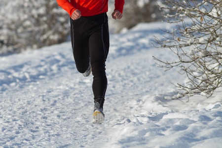 athlete running in the snow