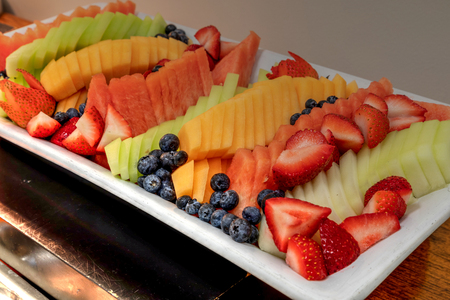 Photo for Fresh fruit platter including watermelon, cantaloupe, honeydew melon, strawberries, pineapple, and blueberries. - Royalty Free Image