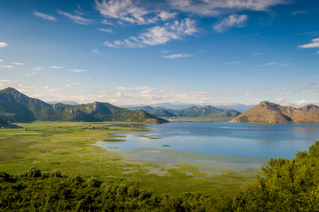 Skadar lake national park. Lake surrounded by mountains. Montenegro.