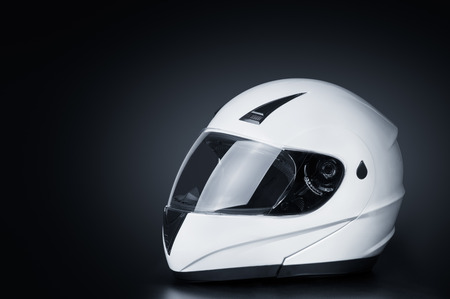 Foto de Blank full face helmet in a black background - Imagen libre de derechos