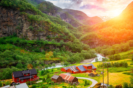 Photo pour Very small village on the shore of a river in Norway at sunset - image libre de droit
