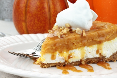 Slice of Double Layer No Bake Pumpkin Pie made with pumpkin, vanilla pudding,cream cheese, and whipped cream.