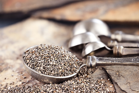 Photo pour Tablespoon of healthy chia seeds with selective focus and extreme shallow depth of field  - image libre de droit