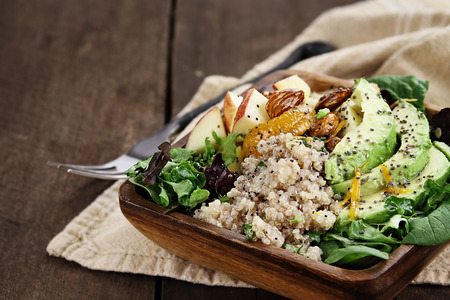 Photo pour Quinoa, avocado and apple salad. Perfect for the detox diet or just a healthy meal. Selective focus with extreme shallow depth of field. - image libre de droit