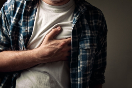 Young adult man suffering from severe heartache.