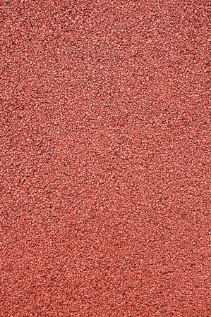 Texture of the artificial running surface for the sport of track and field athletics.