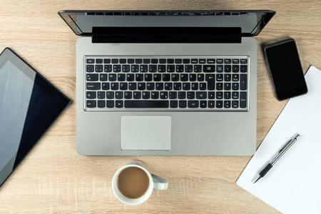 Foto de Office Table top with laptop computer, digital tablet, mobile smartphone and coffee cup. - Imagen libre de derechos