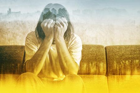 Foto de Social Alienation Concept, Depressed Man covering face and crying in despair. - Imagen libre de derechos