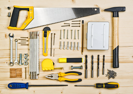Photo pour Assorted Woodwork and Carpentry or Construction Tools on Pine Wood Texture Background. - image libre de droit