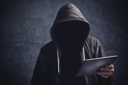 Foto de Faceless unknown unrecognizable anonymous man with digital tablet computer browsing internet. - Imagen libre de derechos