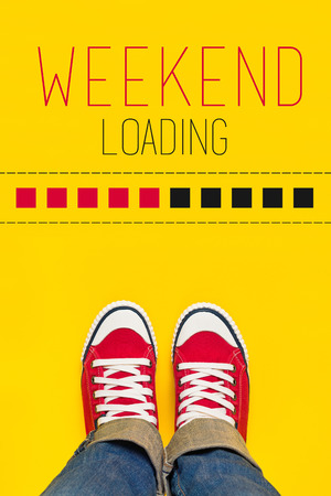 Photo for Weekend Loading Content with Young Person Wearing Red Sneakers from Above Standing in front of Loading Progress Bar, wainting for the End of the Week - Royalty Free Image