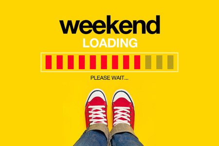 Foto de Weekend Loading Content with Young Person Wearing Red Sneakers from Above Standing in front of Loading Progress Bar, waiting for the End of the Week, Top View - Imagen libre de derechos