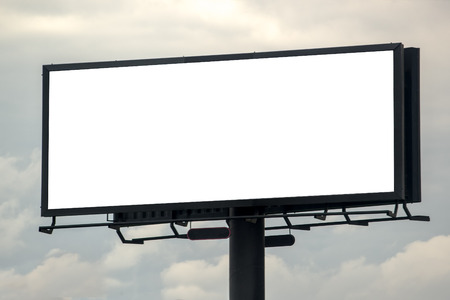 Photo pour Blank Outdoor Advertising Billboard Hoarding Against Cloudy Sky, White Copy Space for Mock Up Design or Marketing Message - image libre de droit