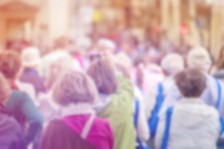Foto de Blurred Crowd of People On Street, Citizenship Concept with Unrecognizable Crowded Population out of Focus, Vintage Toned Image. - Imagen libre de derechos