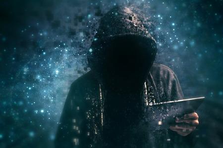 Foto de Pixelated unrecognizable faceless hooded cyber criminal man using digital tablet in cyberspace - Imagen libre de derechos