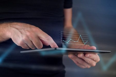 Foto de Business chart diagram on digital tablet computer, hans tapping touch screen to view financial report. - Imagen libre de derechos