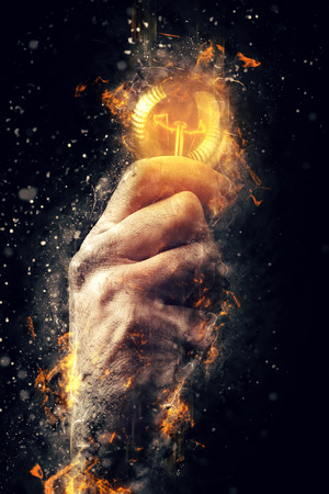 Photo pour Power of creative energy and new ideas and understandings, hand with light bulb as metaphor of innovation and creativity, retro toned image, selective focus. - image libre de droit