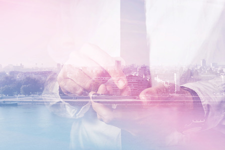Foto für Double exposure of businessman hands with mobile smart phone, finger on touch screen of wireless device, cityscape in background, retro toned image, selective focus - Lizenzfreies Bild