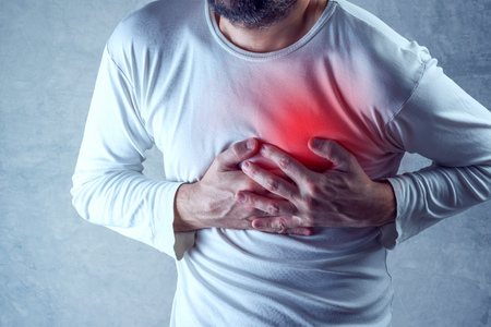 Photo pour Severe heartache, man suffering from chest pain, having heart attack or painful cramps, pressing on chest with painful expression. - image libre de droit