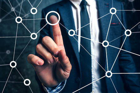 Foto de Businessman connecting the dots in business project management, social networking or teamwork organization. - Imagen libre de derechos