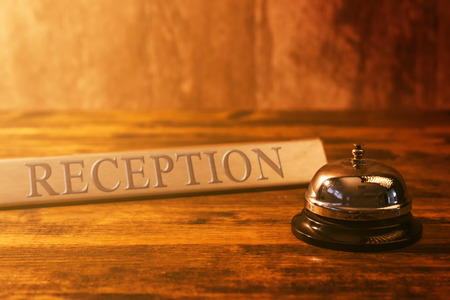 Photo pour Reception bell at hotel check in desk, warm retro tone, selective focus - image libre de droit