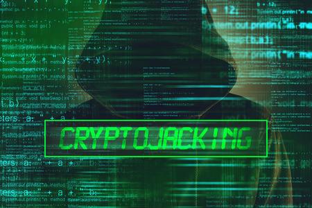 Foto de Cryptojacking concept, computer hacker with hoodie and lines of script code overlaying image - Imagen libre de derechos