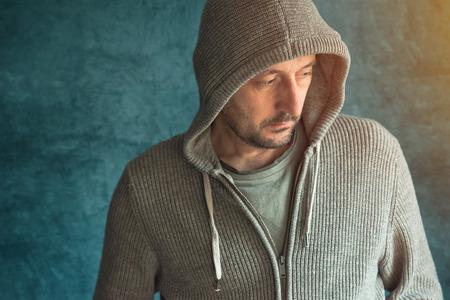 Photo pour Portrait of pensive sad man looking down - image libre de droit