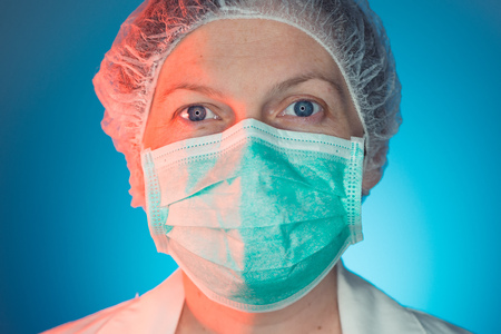 Photo for Headshot portrait of female healthcare professional in uniform looking at camera. Medicine and health industry worker in hospital. - Royalty Free Image